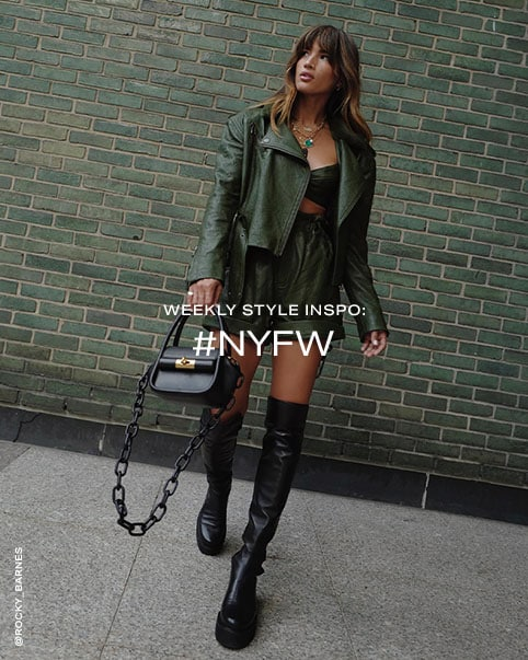 Rocky Barnes wearing a green leather crop top, matching jacket and shorts, and black knee-high boots. Weekly Style Inspo: #NYFW. Shop the Edit.